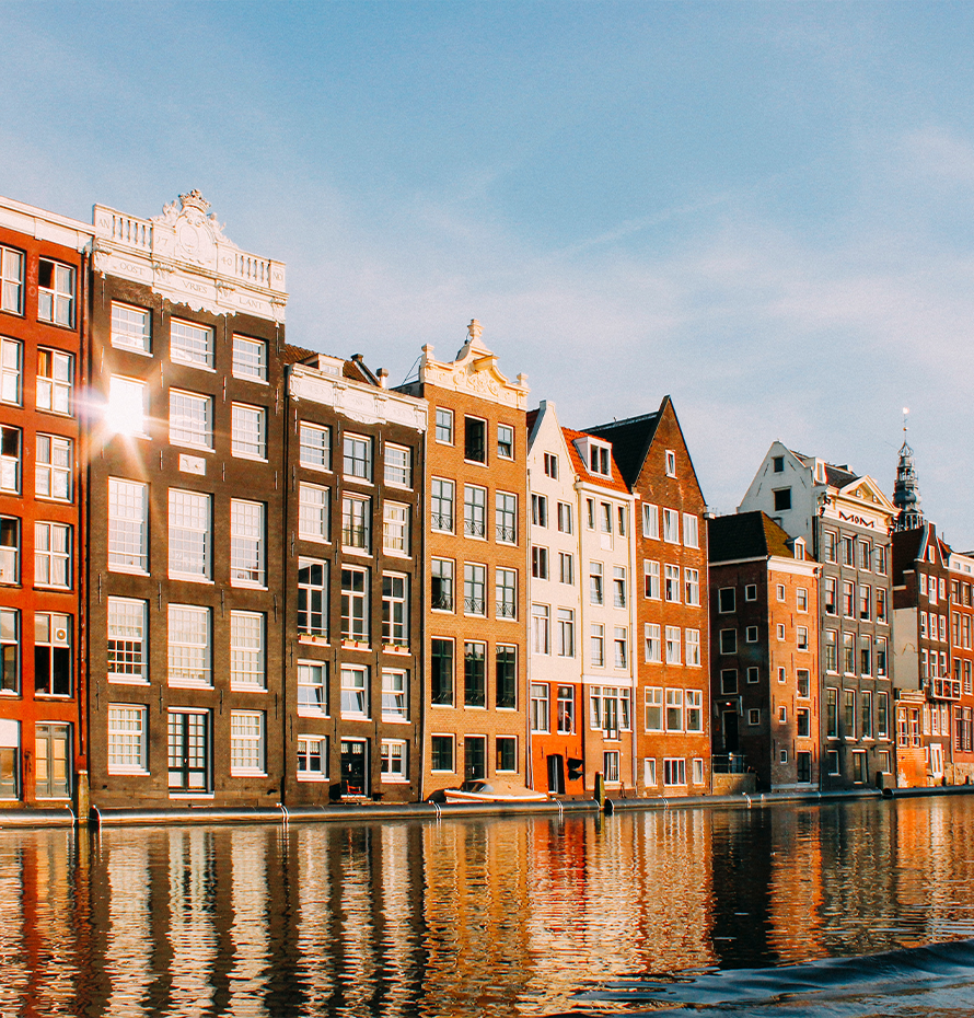 View of Buildings Along the Water on a Clear Day in Amsterdam