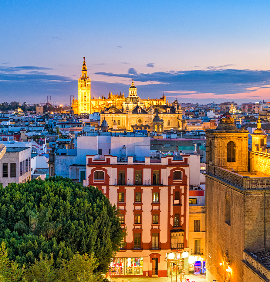 View of Historic Buildings in Spain Lit Up with Light at Sunset