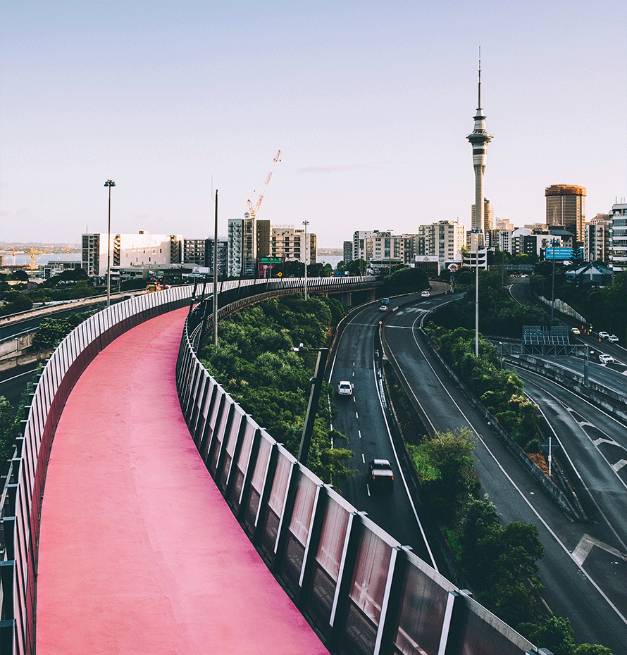 View of Walkway Near Busy Road in Downtown Area of New Zealand